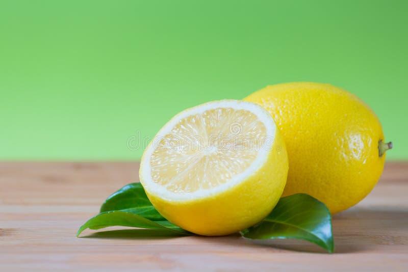 Fresh lemons on a table stock photos