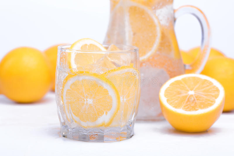 Fresh lemons in water stock photo