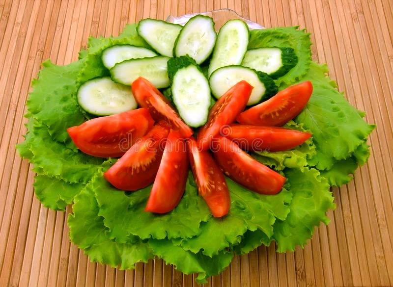Fresh lettuce, tomatoes and cucumbers royalty free stock photography