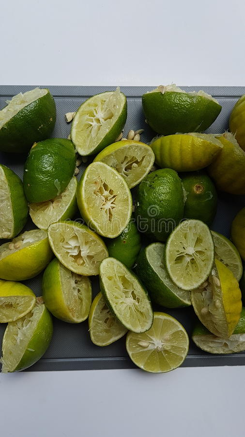 Fresh lime. Colors of green yellow fresh lime and peel royalty free stock photography