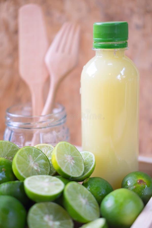 Fresh lime and lemon lemonade. In plastic bottle stock images