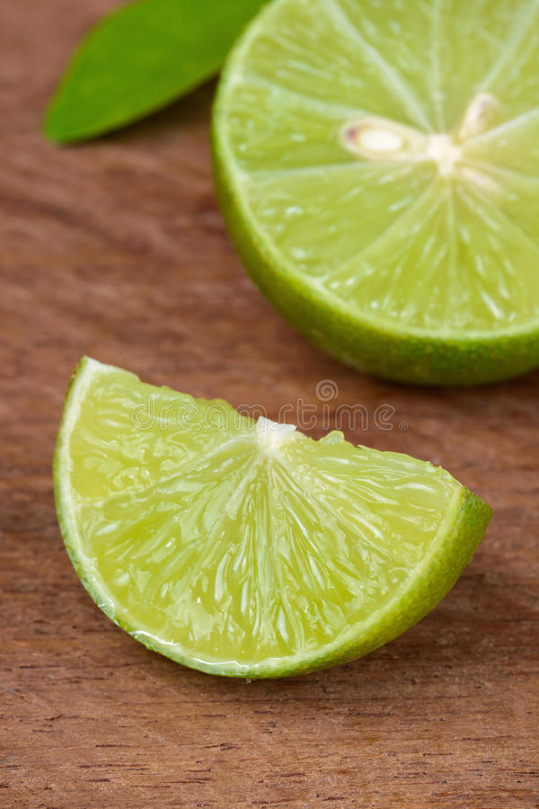 Fresh lime rustic wooden table. Close up of fresh lime rustic wooden table stock image