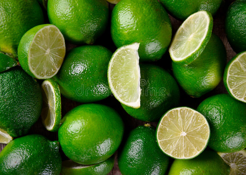 Fresh limes background. Close up stock photos