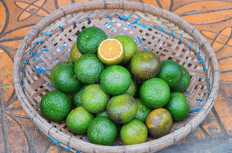 Fresh limes in street market Can Tho Vietnam. Fresh limes at the counter in the street market in Can Tho, in Vietnam stock images