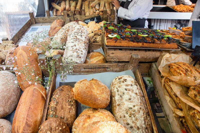 Fresh loaves of bread on display at farmers market. Fresh loaves of bread on retail display at farmers market stock images
