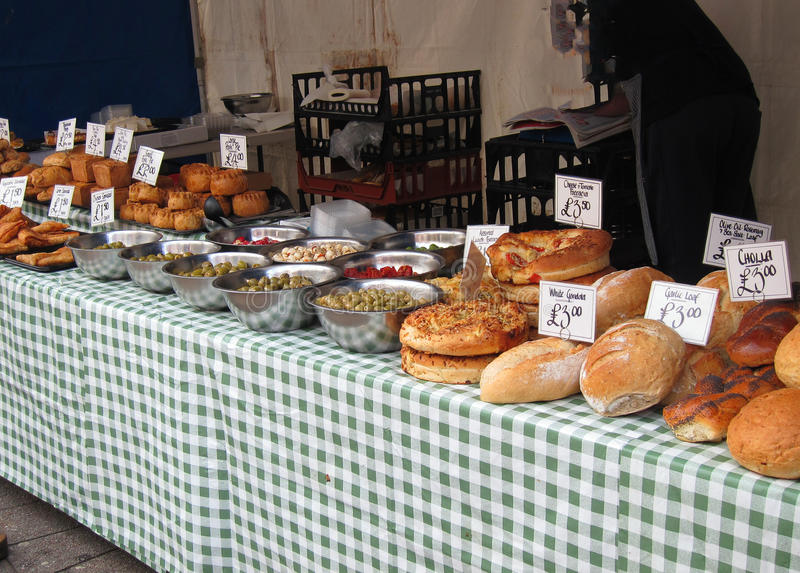 Fresh loaves of bread for sale. A stall selling fresh loaves of bread and pies. There are various types of bread for sale on this market stall. This is in royalty free stock photography