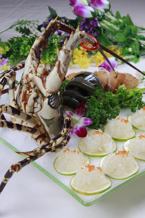 Fresh lobster sushi on ice white plate in restaurant stock photos