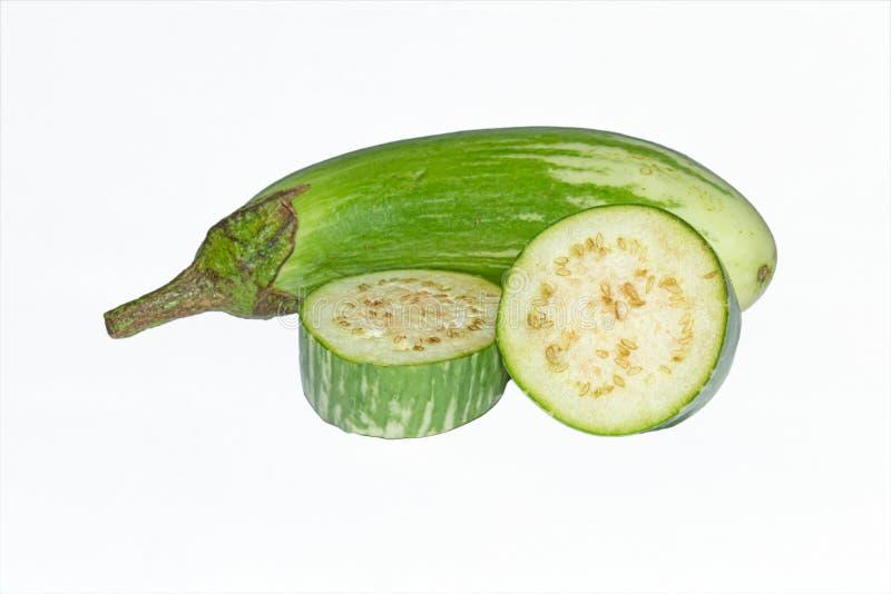 Fresh long green brinjal,thai green eggplant or aubergine on white background. Slices of fresh,raw and organic long green brinjal,thai green eggplant or stock image