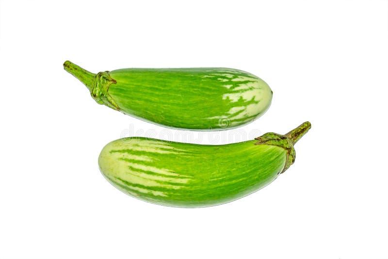 Fresh long green brinjal,thai green eggplant or aubergine on white background. Two fresh,raw and organic long green brinjal,thai green eggplant or aubergine stock photo