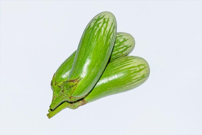 Fresh long green brinjal,thai green eggplant or aubergine on white background. Three fresh,raw and organic long green brinjal,thai green eggplant or aubergine royalty free stock photos