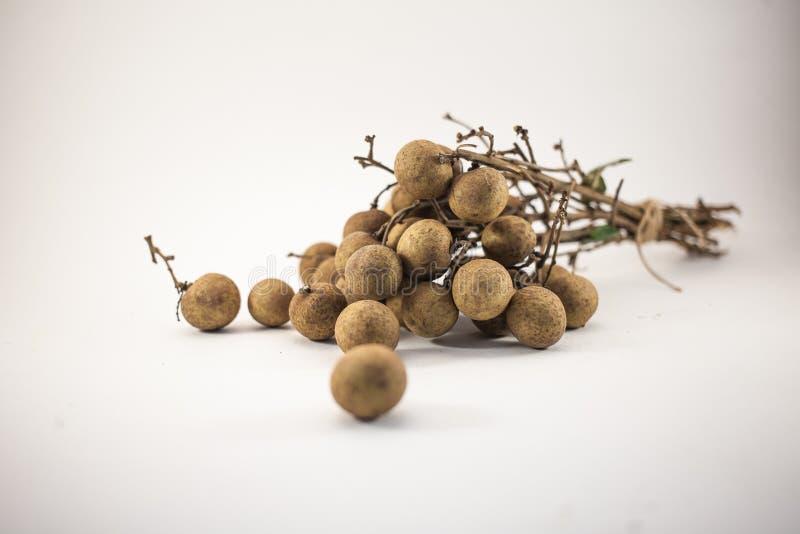 Fresh longan fruits on bench  on white background stock photos