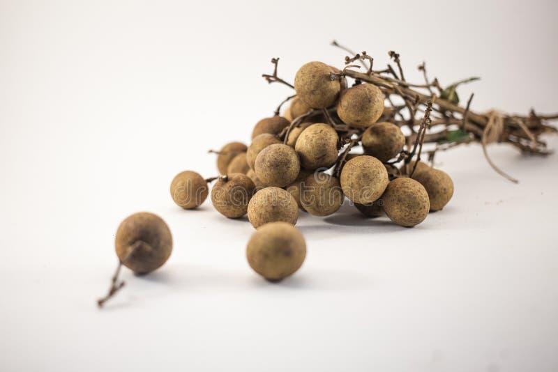 Fresh longan fruits on bench isolated on white background royalty free stock images