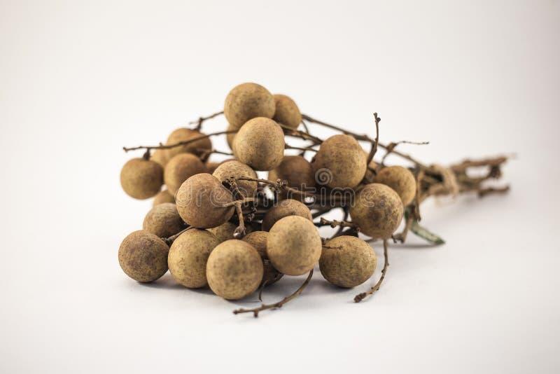 Fresh longan fruits on bench isolated on white background stock image