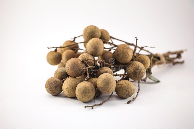 Fresh longan fruits on bench isolated on white background stock photos
