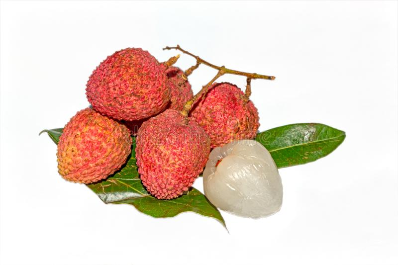Fresh lychee fruit.Close up view of Peeled and unpeeled Lychee fruit on isolated white background with green leaves stock photos