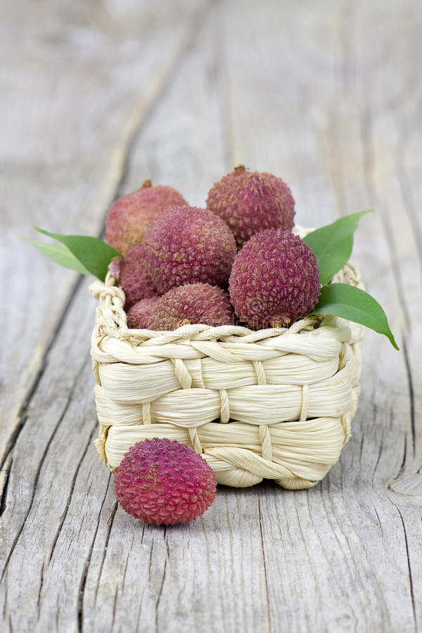 Fresh lychees in a basket royalty free stock photos