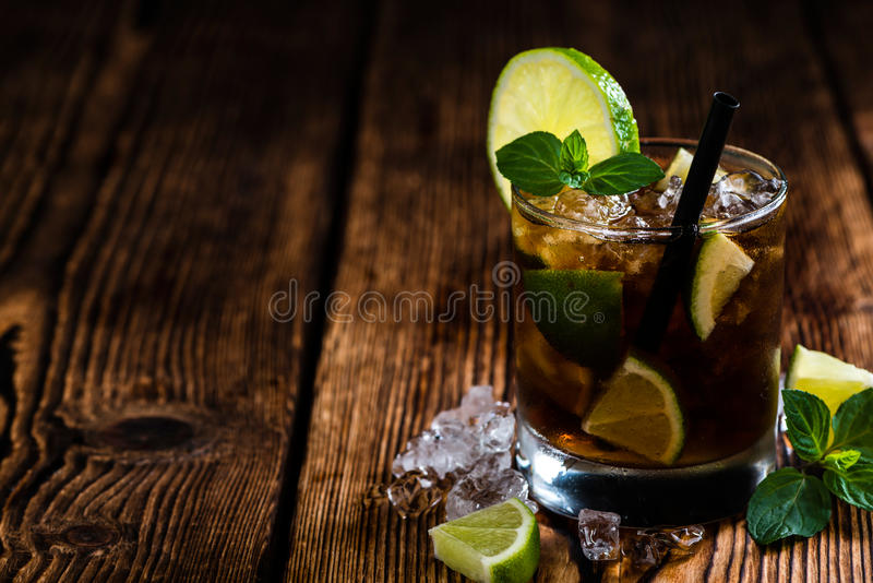 Fresh made Cuba Libre. With brown rum and tasty lime stock images