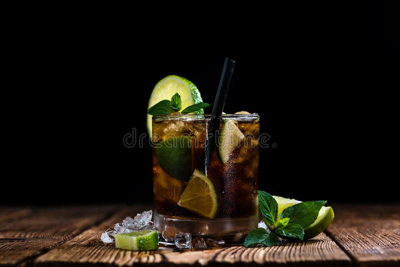 Fresh made Cuba Libre. With brown rum and tasty lime royalty free stock photography