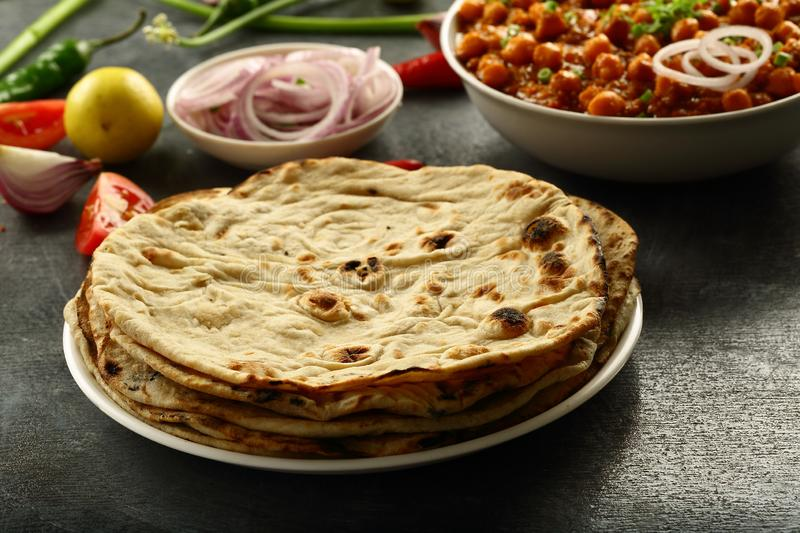 Fresh made Tandoori roti from Indian cuisine. Healthy vegan diet food- homemade roti served with chickpea curry channa masala royalty free stock photos
