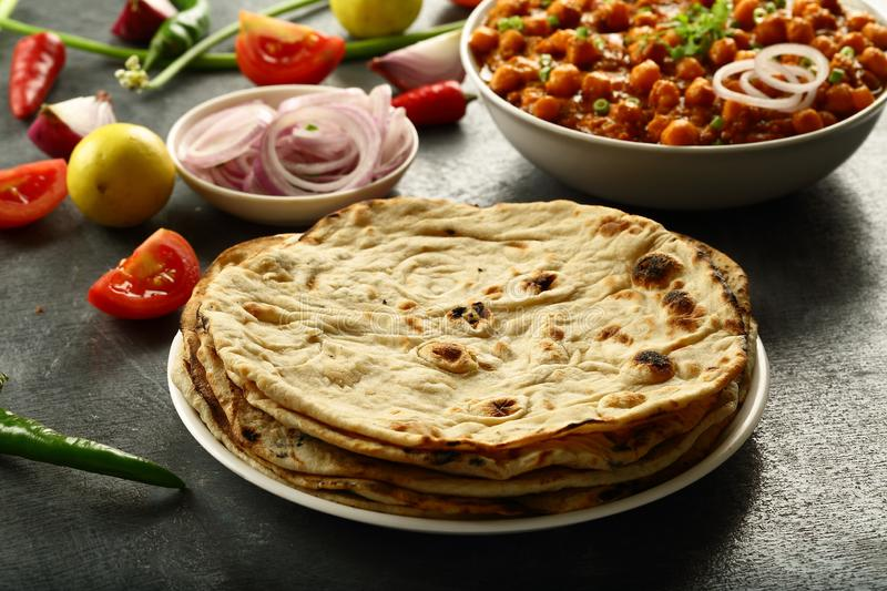 Fresh made Tandoori roti from Indian cuisine. Healthy vegan diet food- homemade roti served with chickpea curry channa masala stock photo