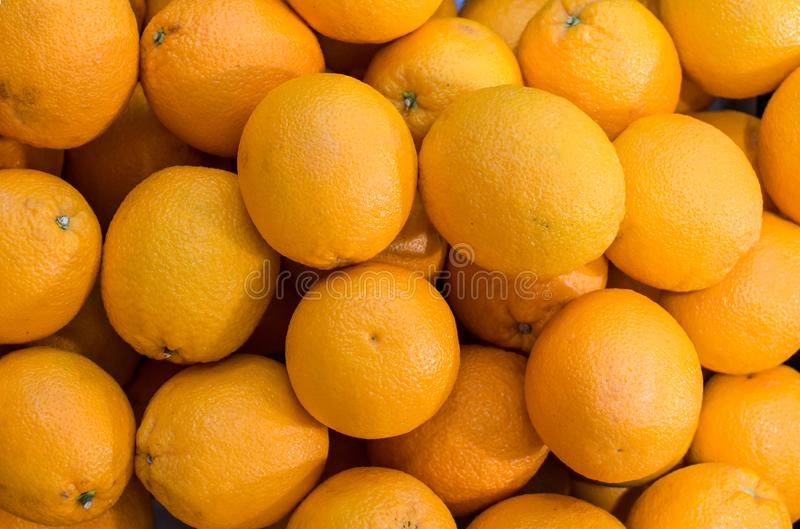 Fresh mandarin oranges texture. Tangerines as the background. Big bunch of ripe tangerines. royalty free stock images