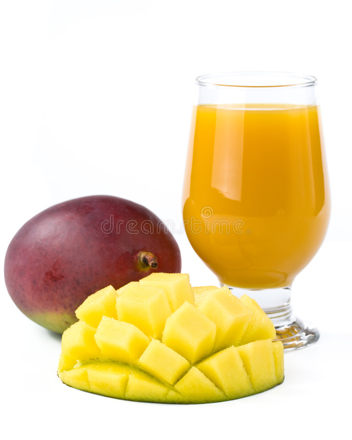 Fresh mango and glass of mango juice royalty free stock photography