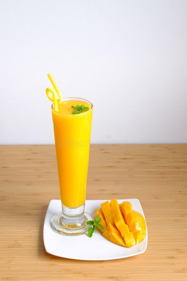 Free Fresh Mango Juice Smoothie And Mango Fruit With Bamboo Basket Stock Images - 68826464