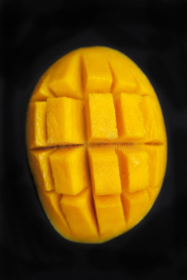 Fresh mango organic product. Dark background. Close up. Top view. stock image