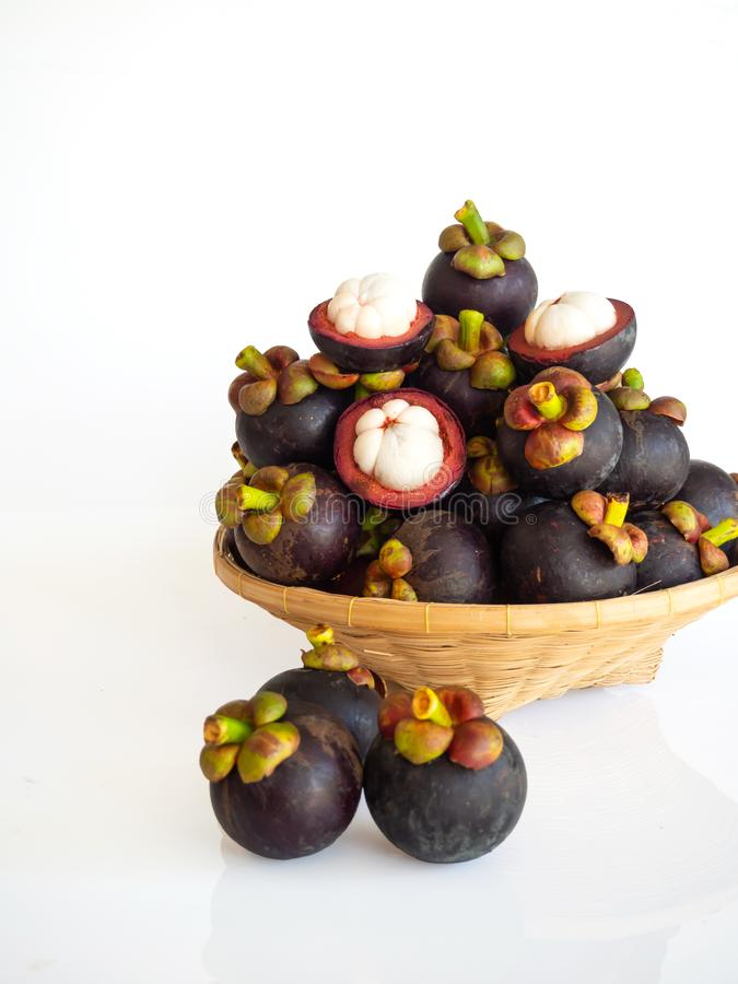 Fresh mangosteen in bamboo basket on white isolate background. Healthy and sweet fruit. High vitamins stock image
