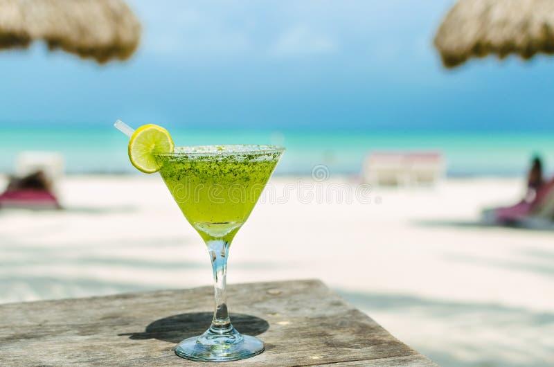 Fresh Margarita cocktail on a beach table royalty free stock photos