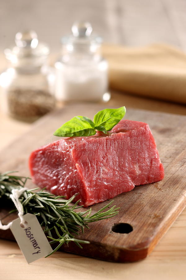 Fresh Meat. Raw fresh meat on a cutting board royalty free stock image