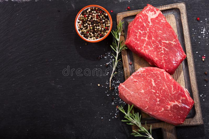 Fresh meat with ingredients for cooking, top view stock photography