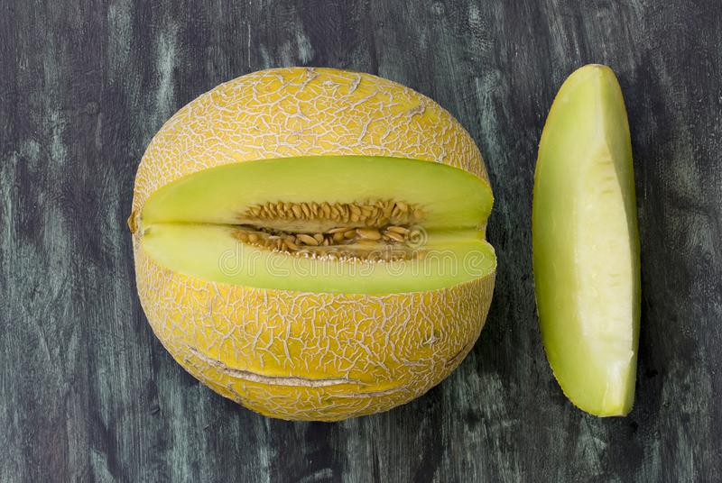 Fresh melon. Fresh cantaloupe cut into pieces on wooden table.Directly above view stock photography