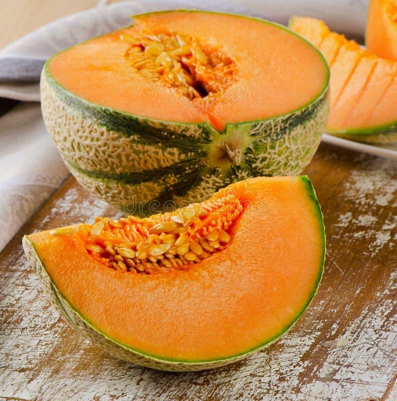 Fresh melon on wooden table. Fresh cantaloupe melon on wooden board. Selective focus stock image
