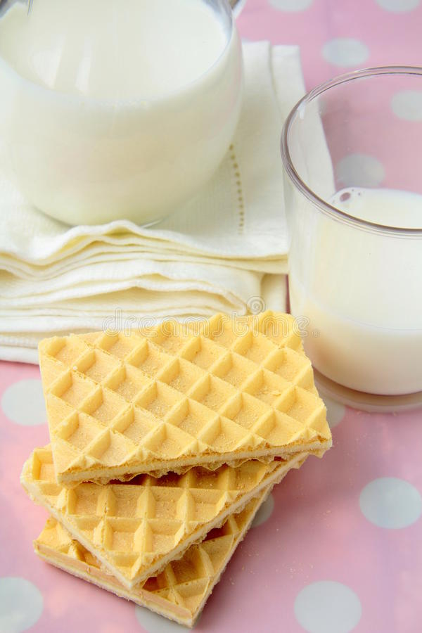 Fresh milk and cookies stock images