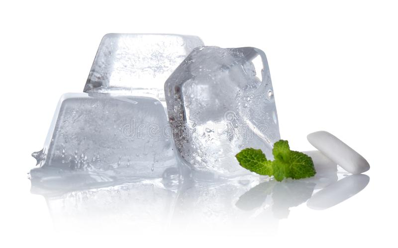 Fresh mint, chewing gums and ice cubes on white stock photo