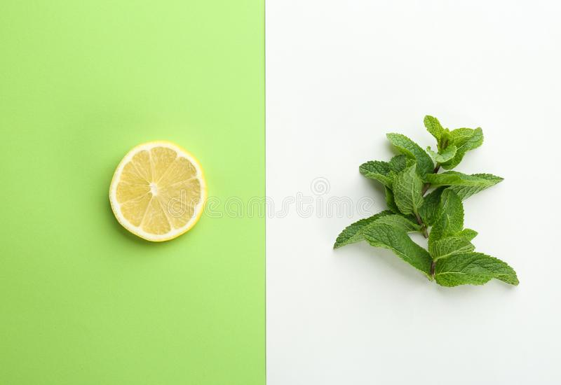 Fresh mint leaves and citrus fruit. On color background, top view royalty free stock photo