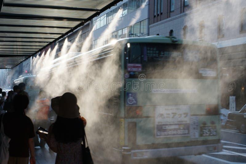 Fresh mist shower at Shijo Takakura bus stop on hot summer days. Kyoto,Japan-July 30,2019: Fresh mist shower at Shijo Takakura bus stop on hot summer days stock photography