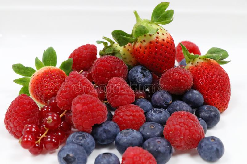 Fresh mixed berries stock images