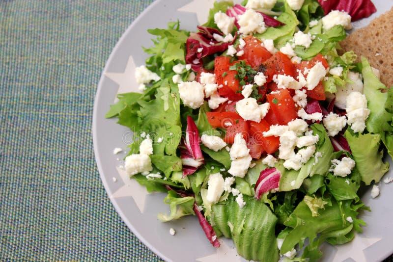 Mixed salad with feta cheese royalty free stock photo