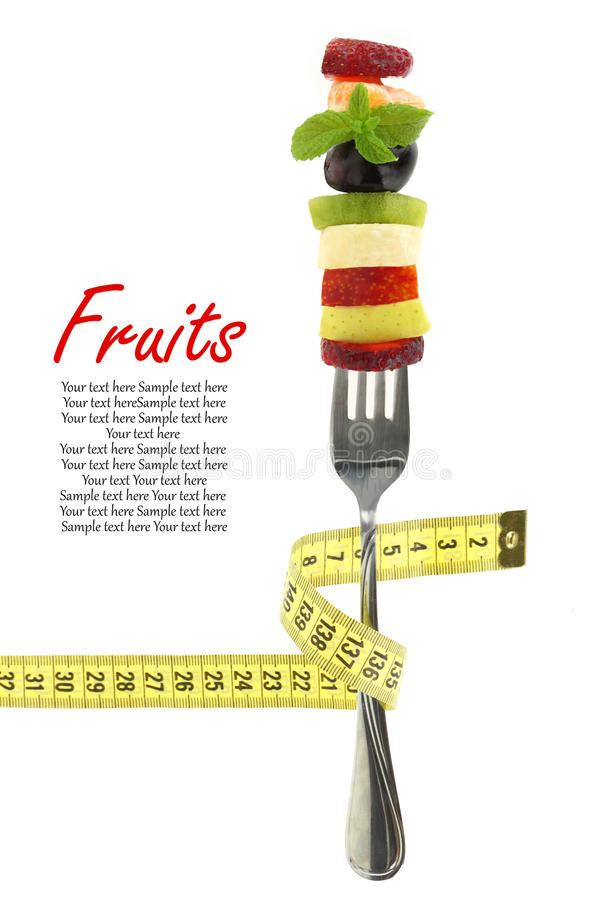 Fresh mixed slices of fruits on a fork stock photos