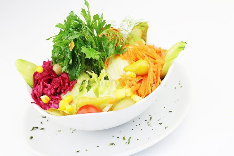 Fresh mixed vegetable salad on isolated white background royalty free stock photos