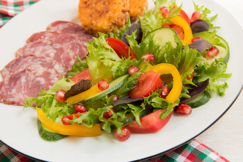 Fresh Mixed Vegetable Salad And Sliced Sausage Royalty Free Stock Image