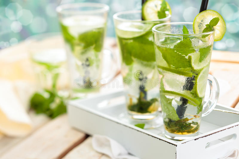 Fresh mojito cocktail. Refreshing mojito drink on white rustic table royalty free stock photography