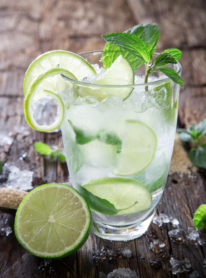Fresh mojito drink. On wooden table stock images