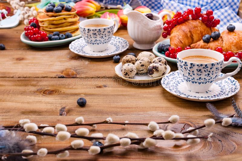 Fresh morning coffee and pastries homemade for breakfast. Delicious food for a romantic breakfast and spring flowers. The concept royalty free stock photography
