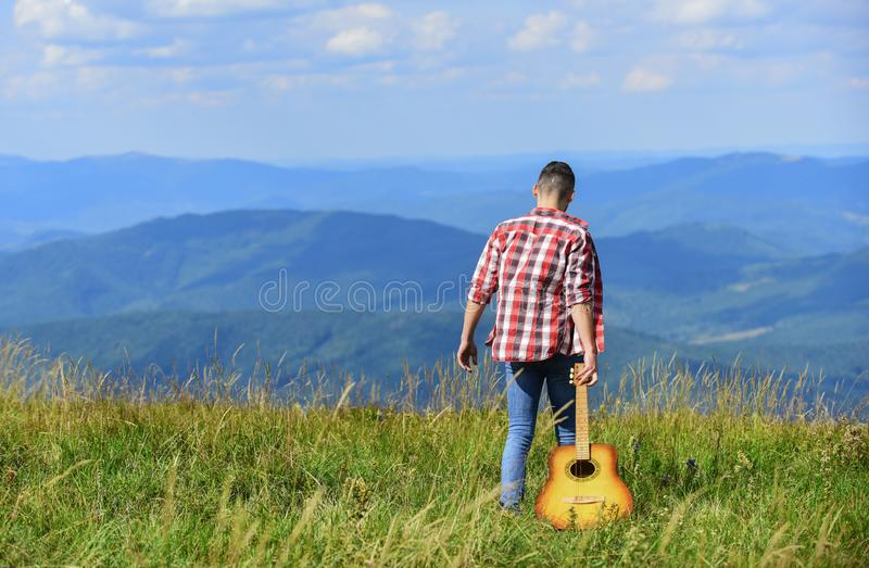 Fresh mountain air. Exploring nature. Beauty of nature. Best way to escape from city. Walking alone. Man with guitar stock image