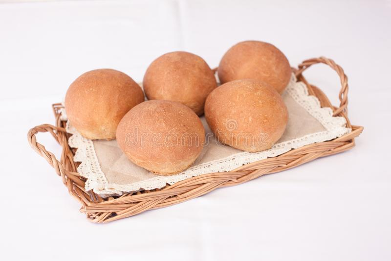 Fresh mouth-watering buns. Several delicious round buns royalty free stock photo