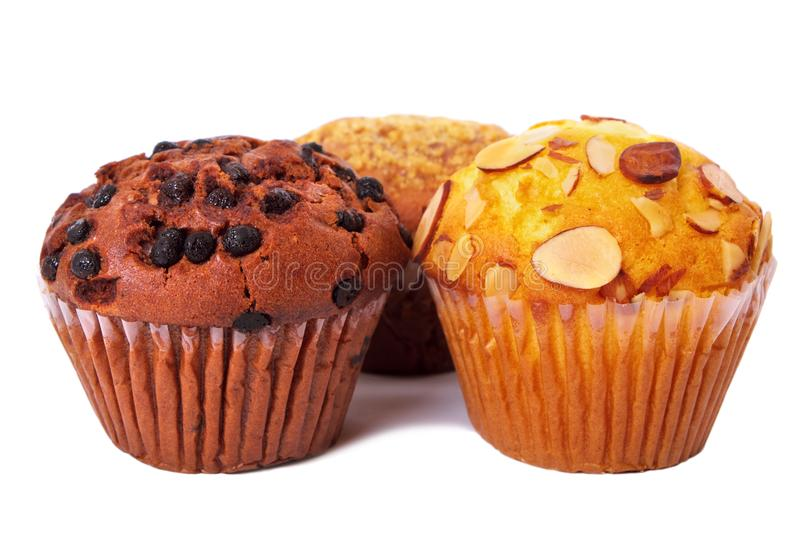 Fresh muffin cup cakes isolated white background stock images