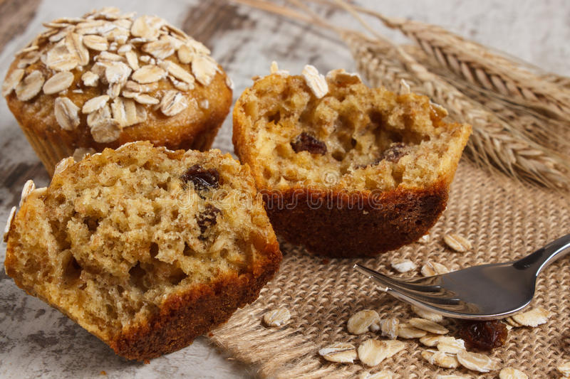 Fresh muffins with oatmeal baked with wholemeal flour and ears of rye grain, delicious healthy dessert stock photos